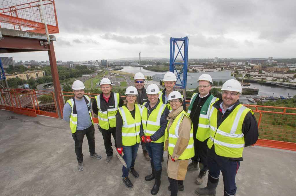 Project managers and designers NIXON on top of Scotway house