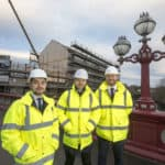 Quantity surveyors standing outside riverside view project