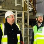 Intern being shown round scotway house by project manager